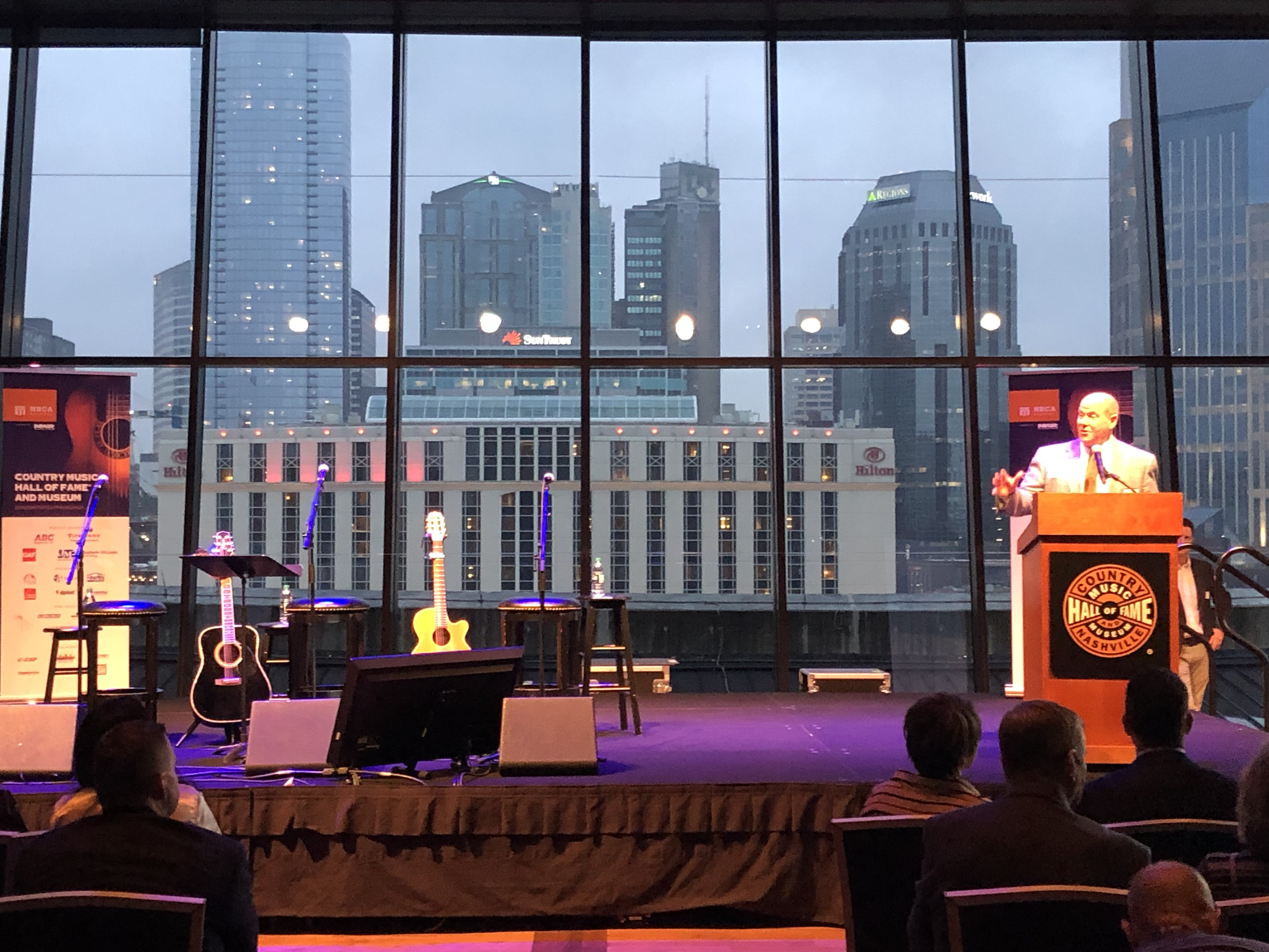 Reid Ribble, NRCA's CEO, speaks at the ROOFPAC songwriter extravaganza event at the Country Music Hall of Fame® and Museum in Nashville, Tenn., during IRE.